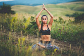 Woman doing yoga in the nature