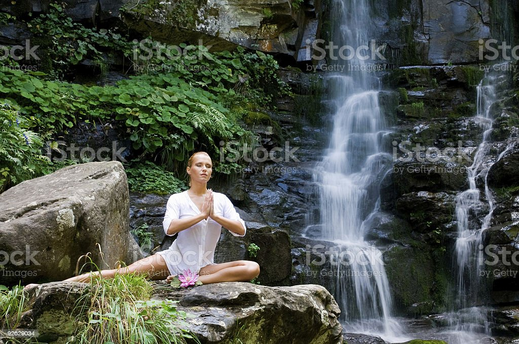 Woman doing yoga in the nature royalty-free stock photo