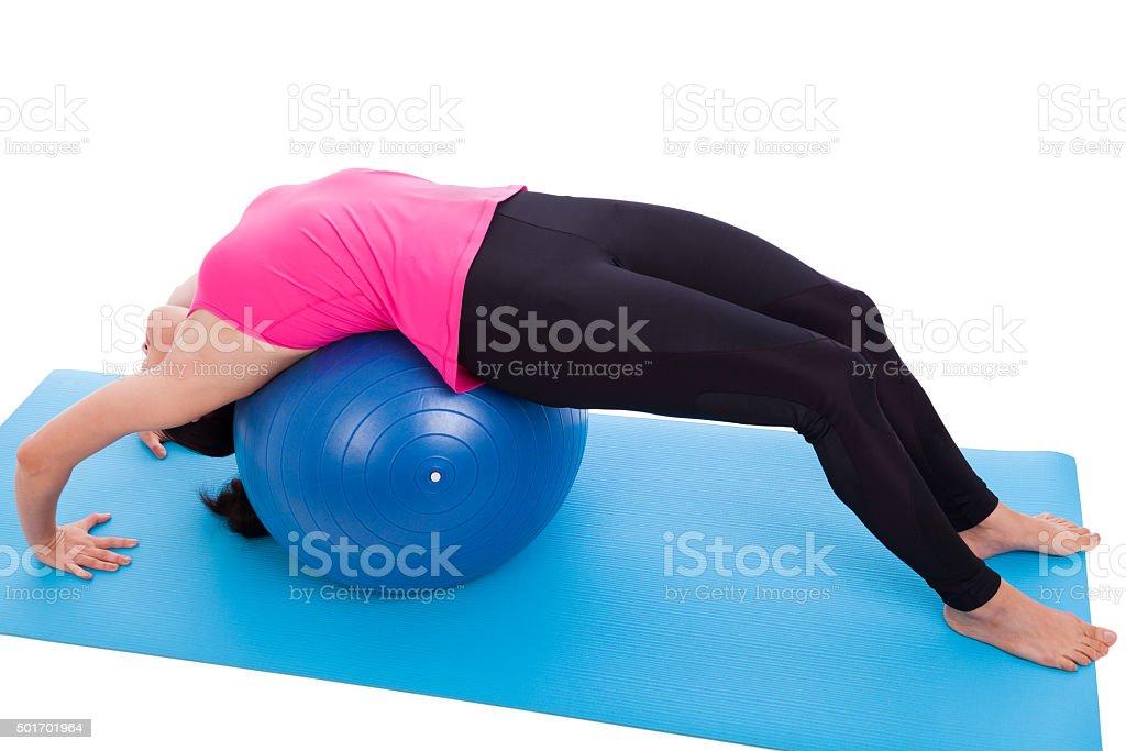 Woman doing yoga,  lies on gym ball. Isolated on white. stock photo