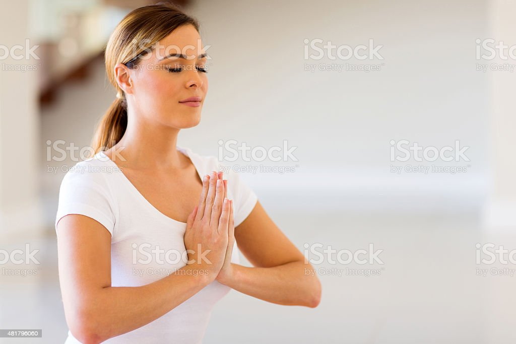 woman doing yoga meditation stock photo