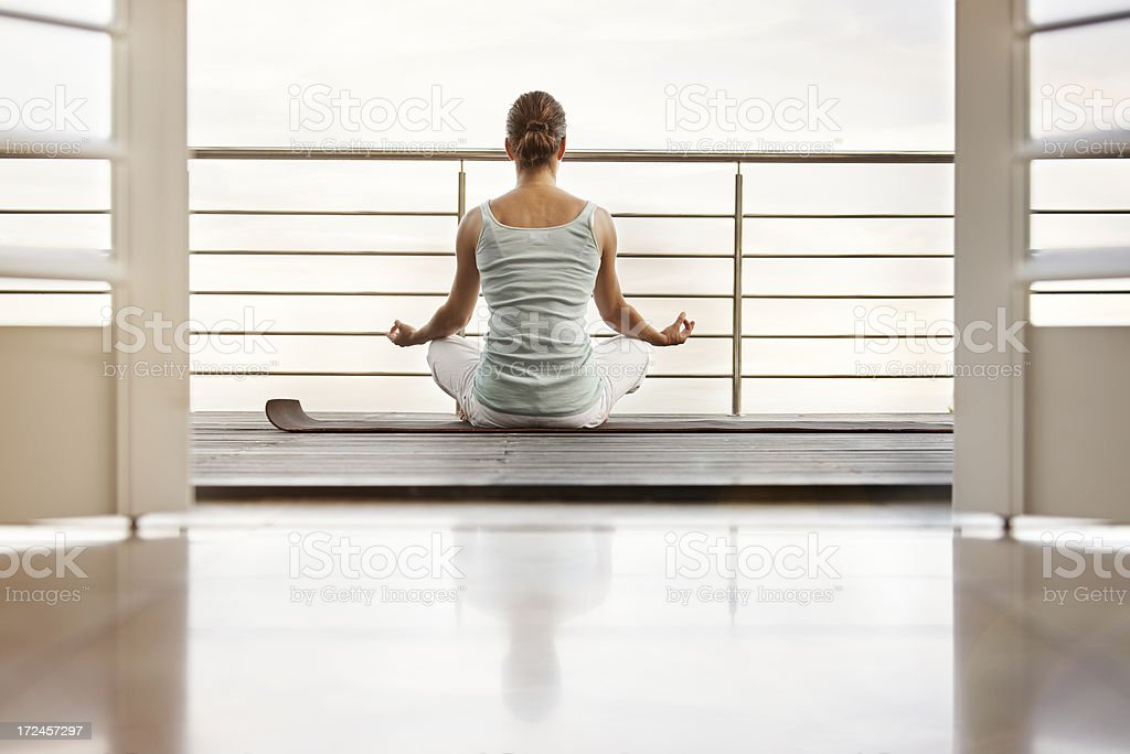 Woman doing yoga on balcony royalty-free stock photo