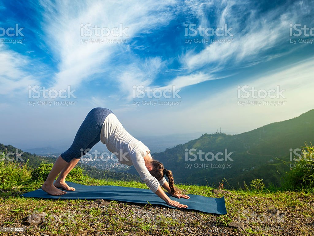 Woman doing yoga oudoors in mountains stock photo