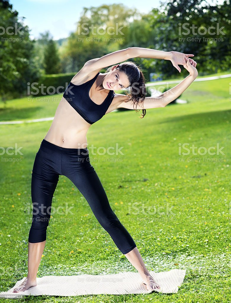 Woman Doing Yoga Outdoors royalty-free stock photo