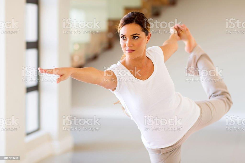 woman doing yoga pose stock photo