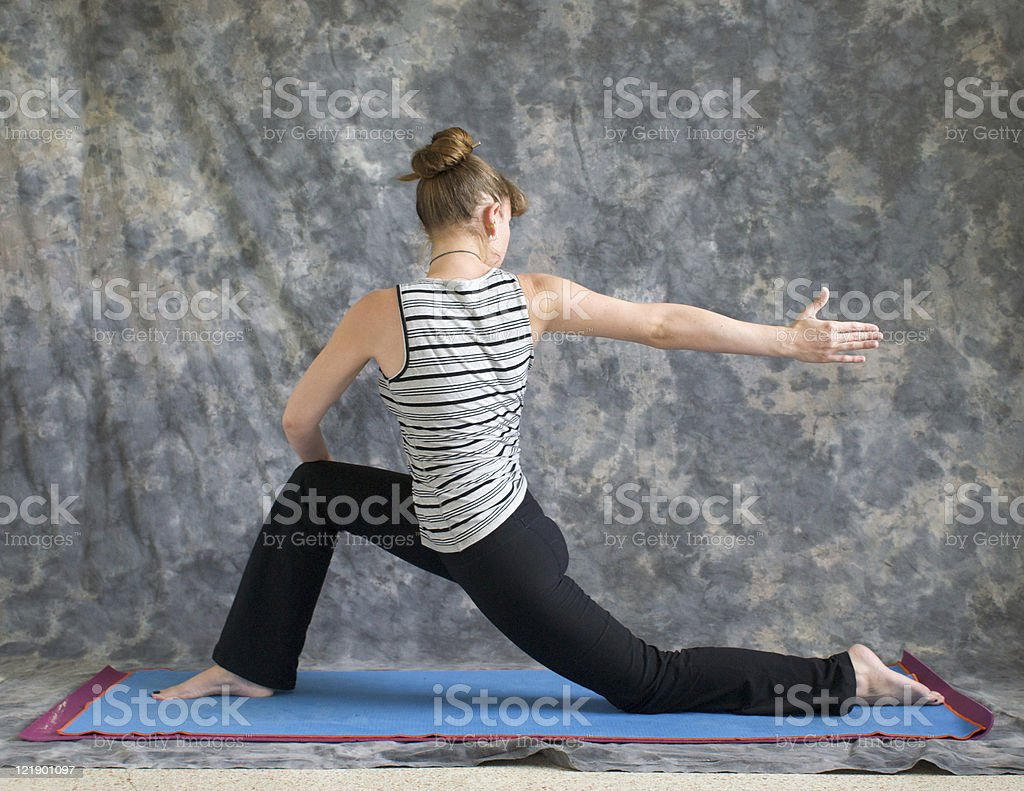 woman doing Yoga posture rotated Low Lunge or Ashwa Sanchalanasana stock photo