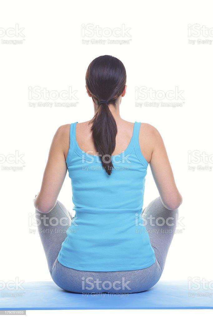 Woman doing yoga rear view royalty-free stock photo