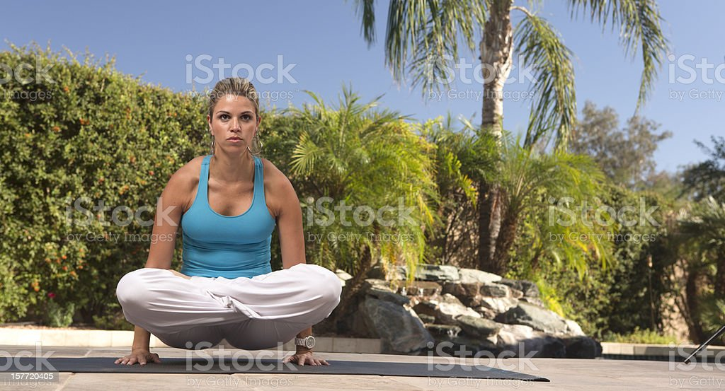 Woman doing yoga Scales Pose royalty-free stock photo