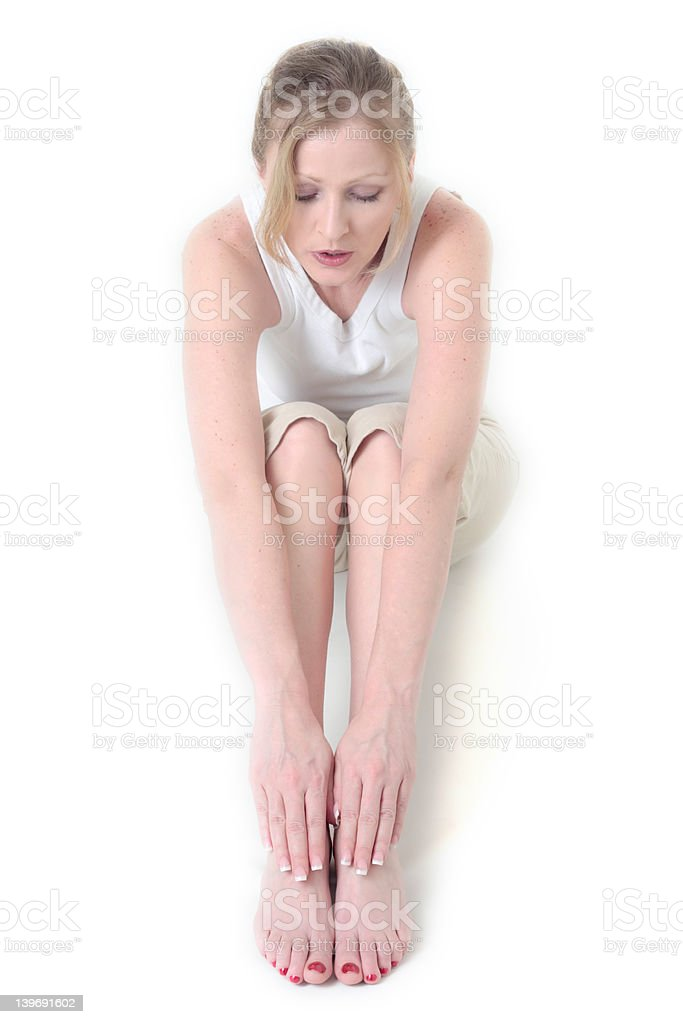 Woman doing yoga stretch royalty-free stock photo