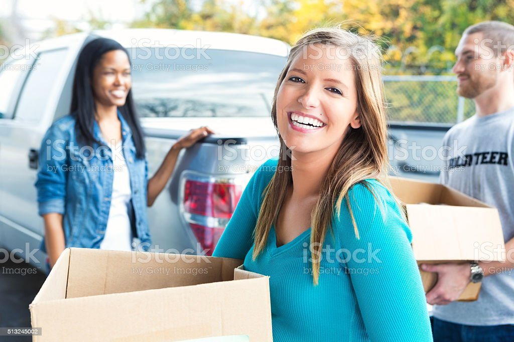 Woman donating items to charity stock photo