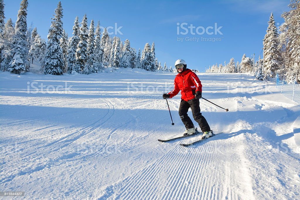 Woman down hill skiing in Lapland Finland stock photo