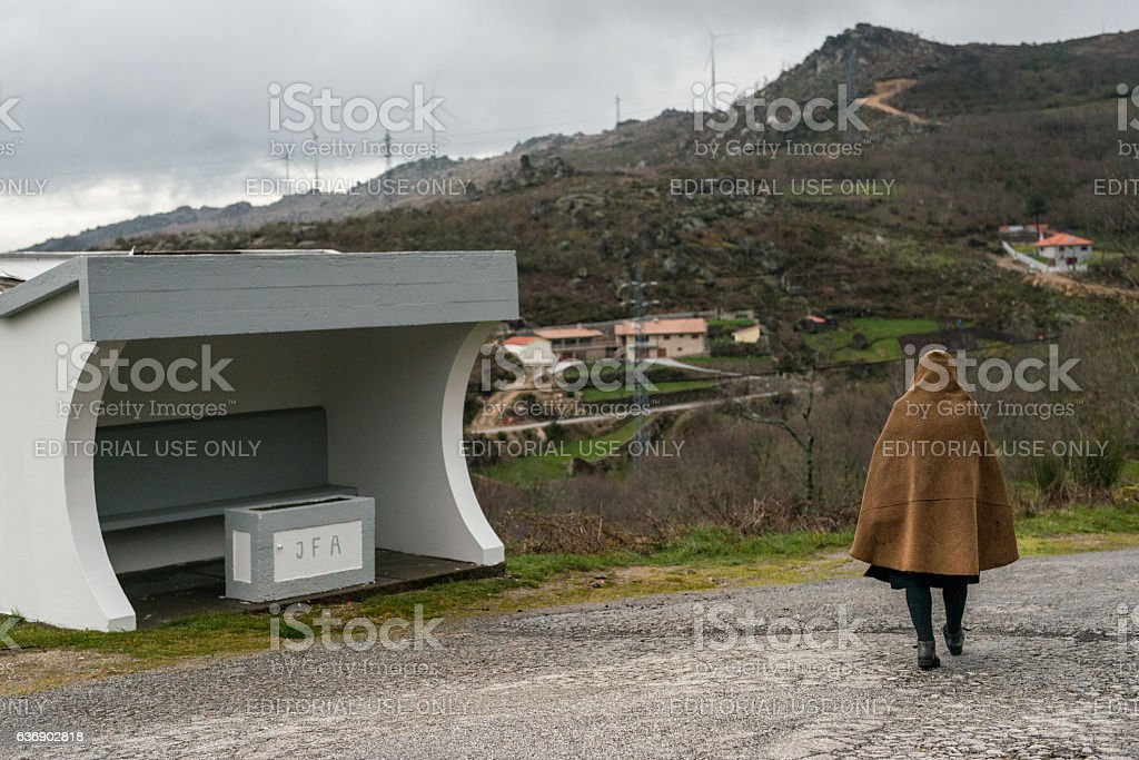Woman down the road, Serra da Gralheira, Portugal stock photo