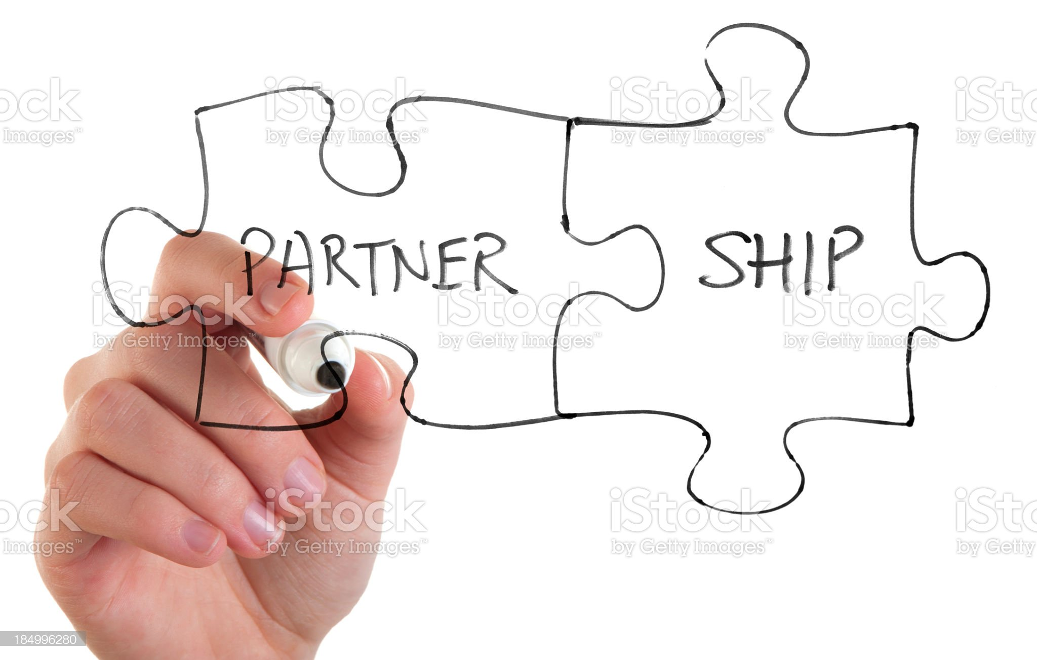 Woman drawing a partnership jigsaw concept royalty-free stock photo