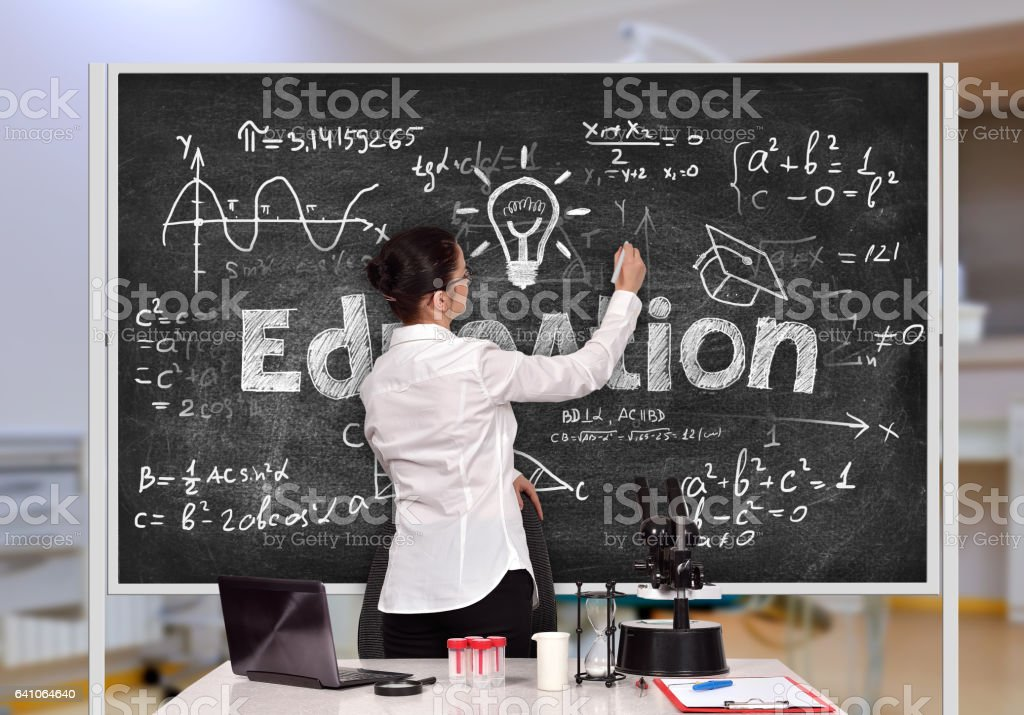 woman drawing formula stock photo
