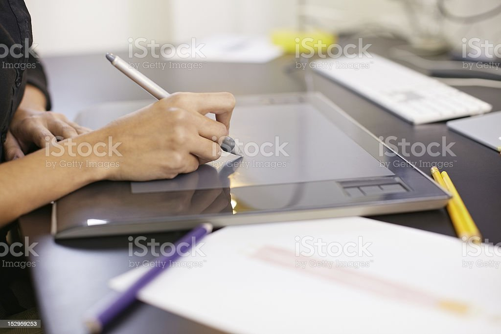Woman drawing sketches on computer in fashion design studio stock photo