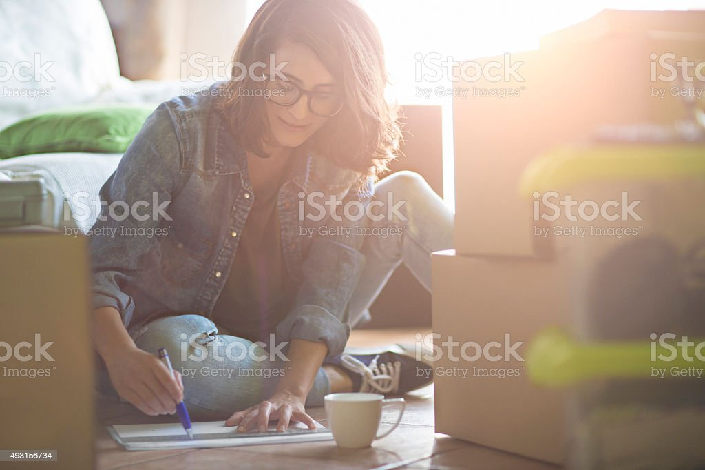 Woman drawing the new home decoration stock photo
