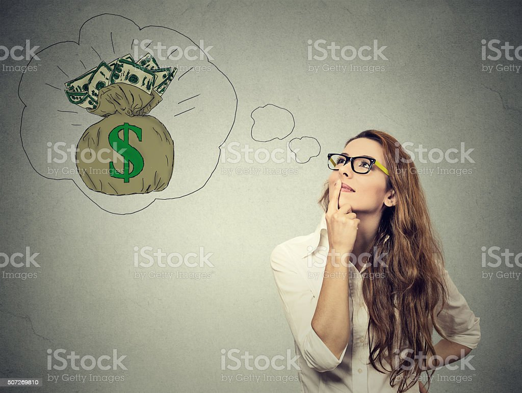 Woman dreaming of financial success stock photo