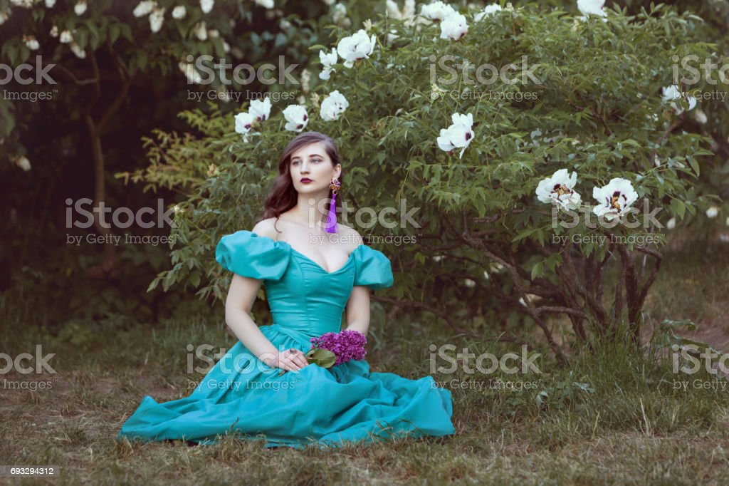 Woman dreams of sitting under a bush. stock photo