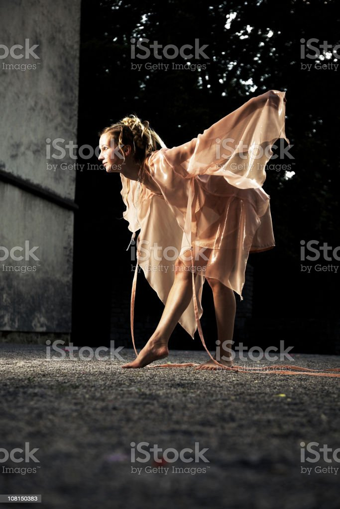 Woman Dressed as a Fairy and Posing in Courtyard stock photo
