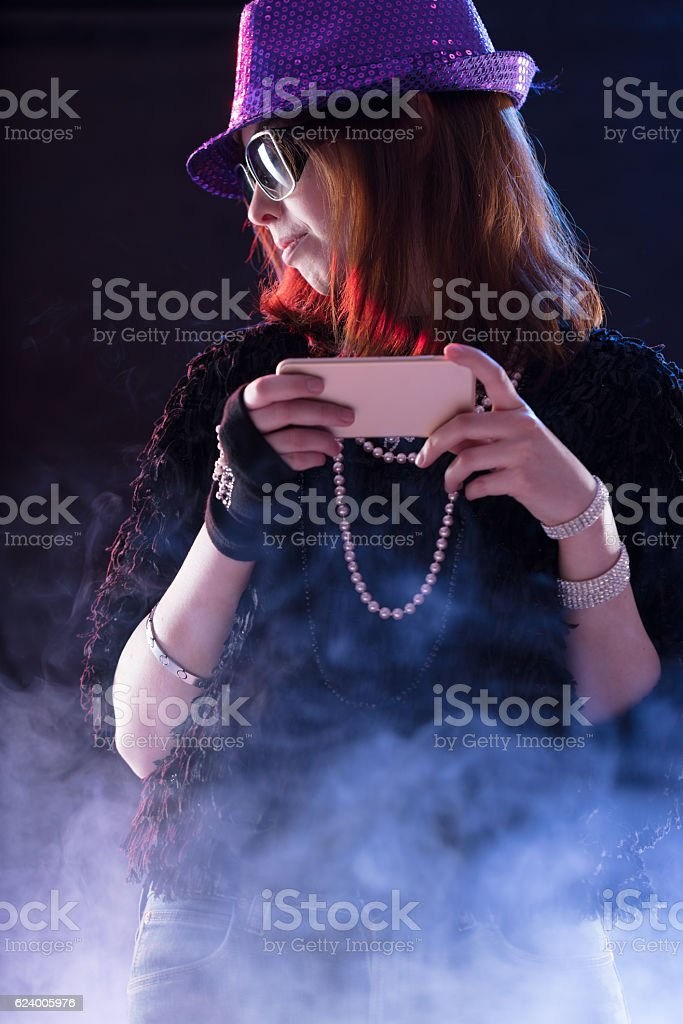 woman dressed as a popstar with a mobile stock photo
