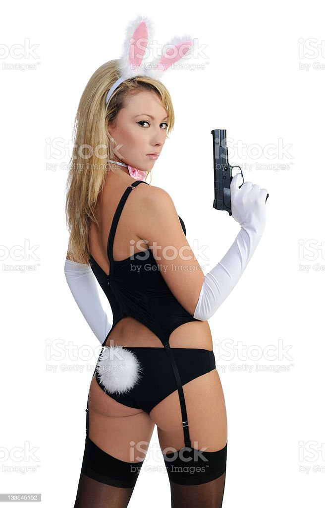 Woman dressed as a rabbit holding a gun stock photo