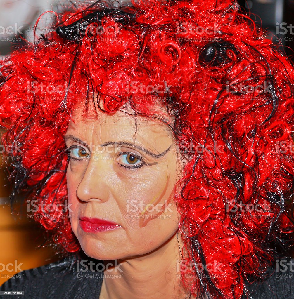 Woman dressed as a witch for Halloween or Carnival stock photo