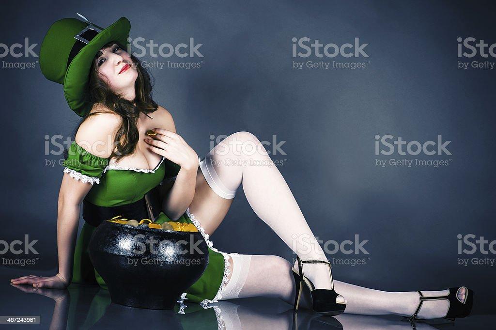 woman dressed as leprechaun stock photo