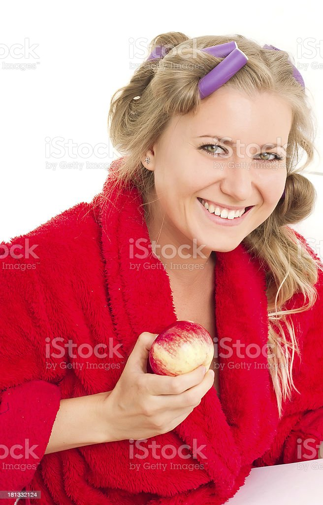 woman dressed bathrobe with an apple royalty-free stock photo