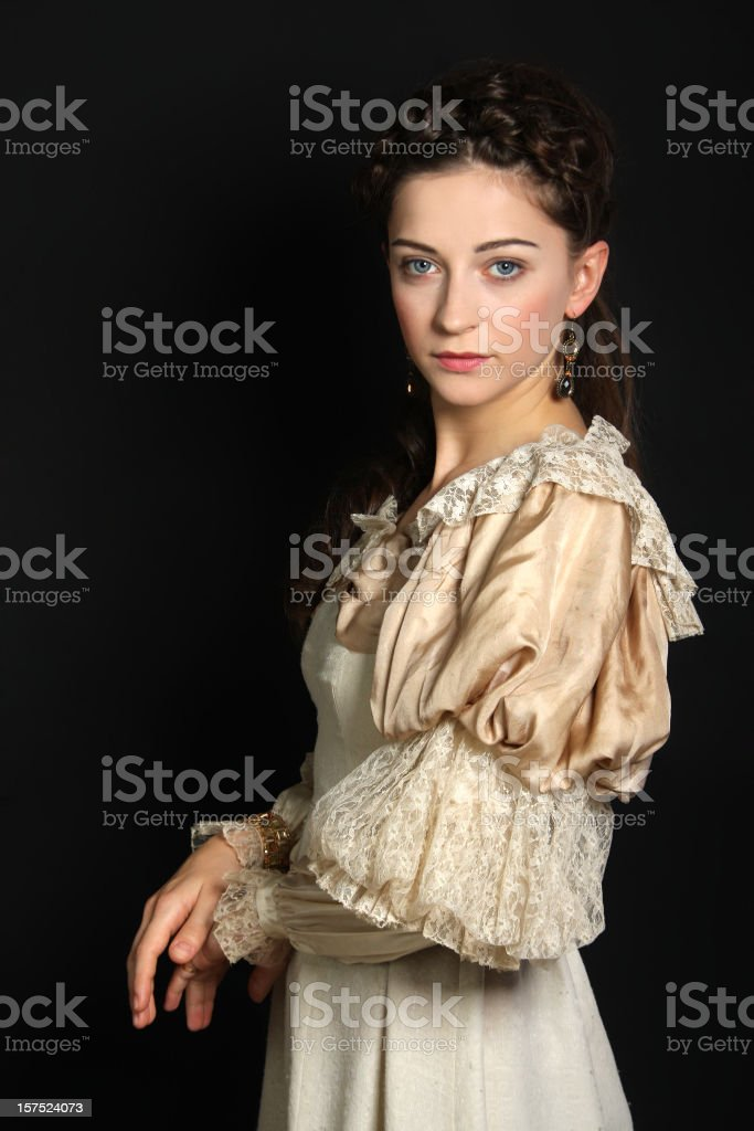A woman dressed in baroque-era clothing royalty-free stock photo
