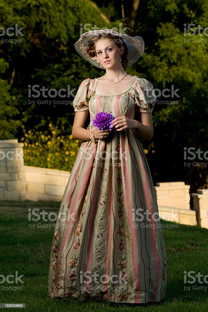 A woman dressed in clothing from the Victorian era stock photo