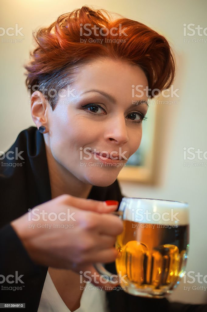 Woman drink beer stock photo