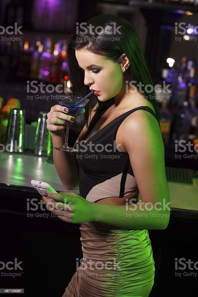 Woman drink blue vodka in bar royalty-free stock photo