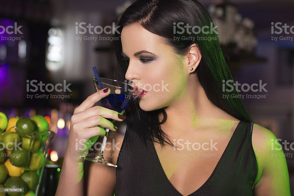 Woman drink cocktail in bar at night royalty-free stock photo