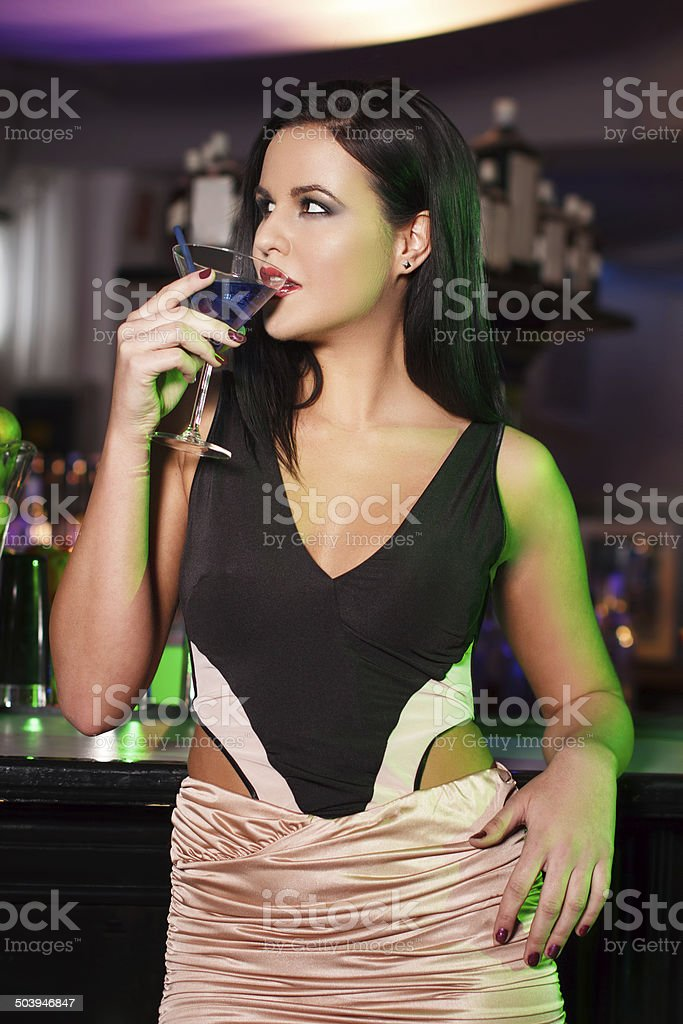 woman drink martini in bar royalty-free stock photo