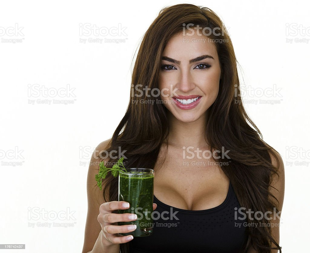 Woman drinking a fresh juiced drink stock photo