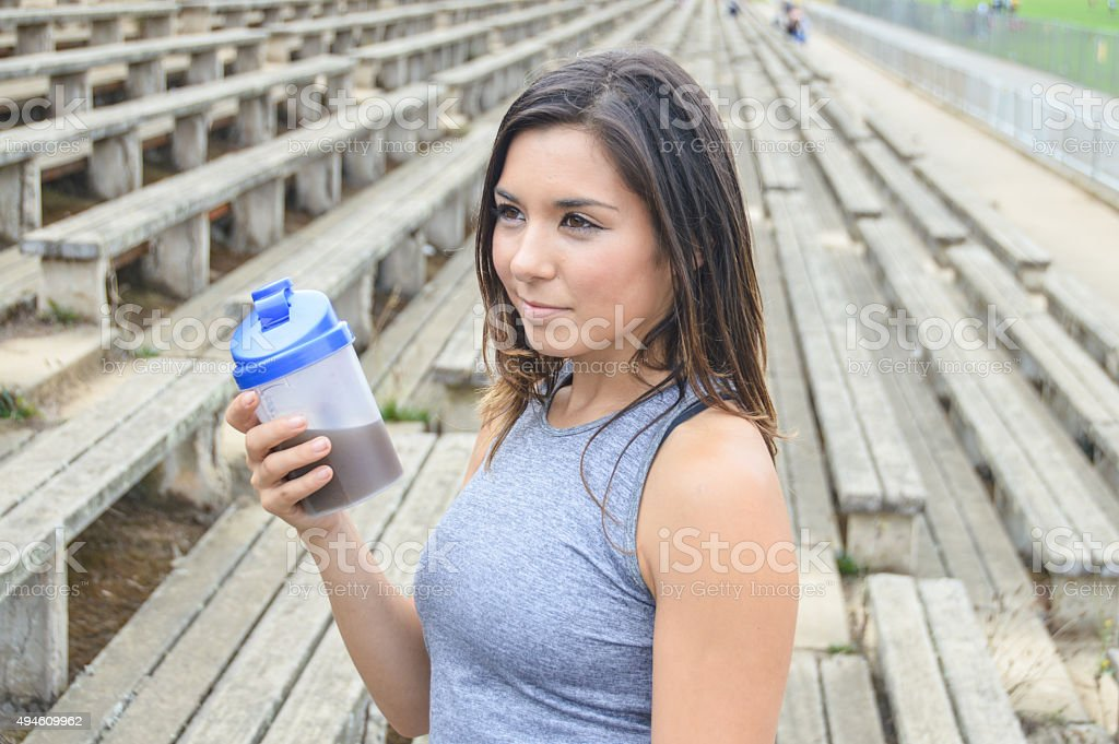 Woman drinking a meal replacement shake (protein shake) stock photo