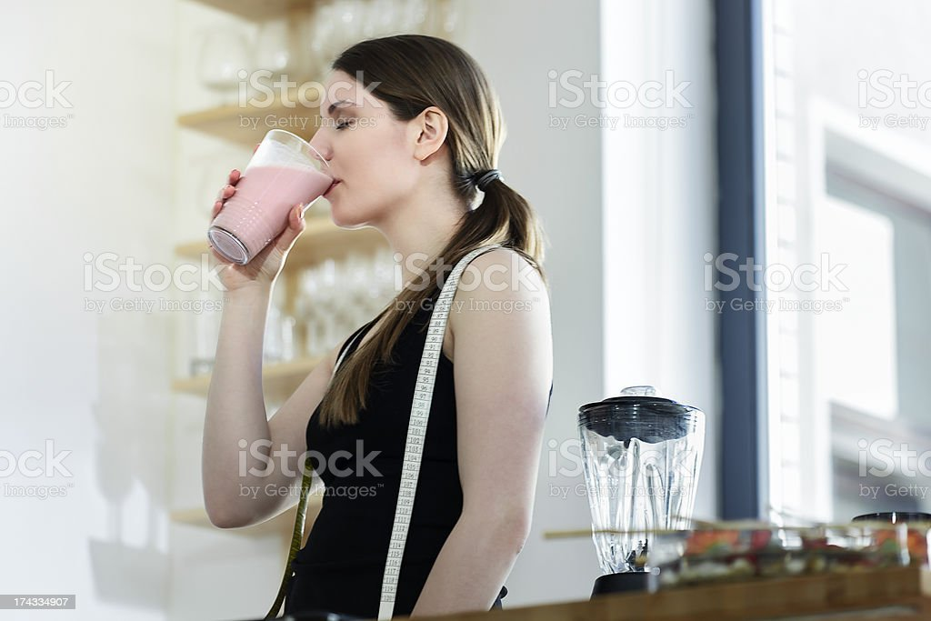 Woman Drinking a Meal Replacement Shakes stock photo