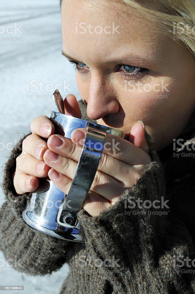 Woman Drinking a Mug of Hot Tea royalty-free stock photo