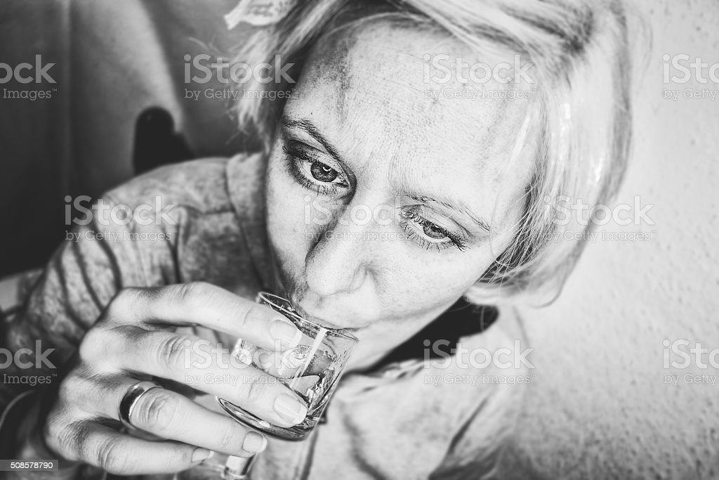 Woman drinking a short alcoholic drink stock photo