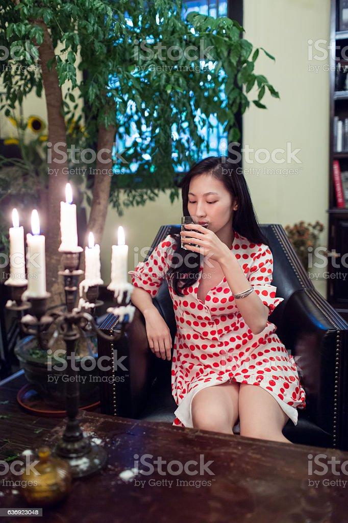 woman drinking alone stock photo