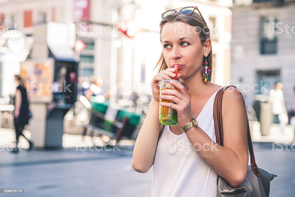 Woman drinking Bubble Tea in the city stock photo