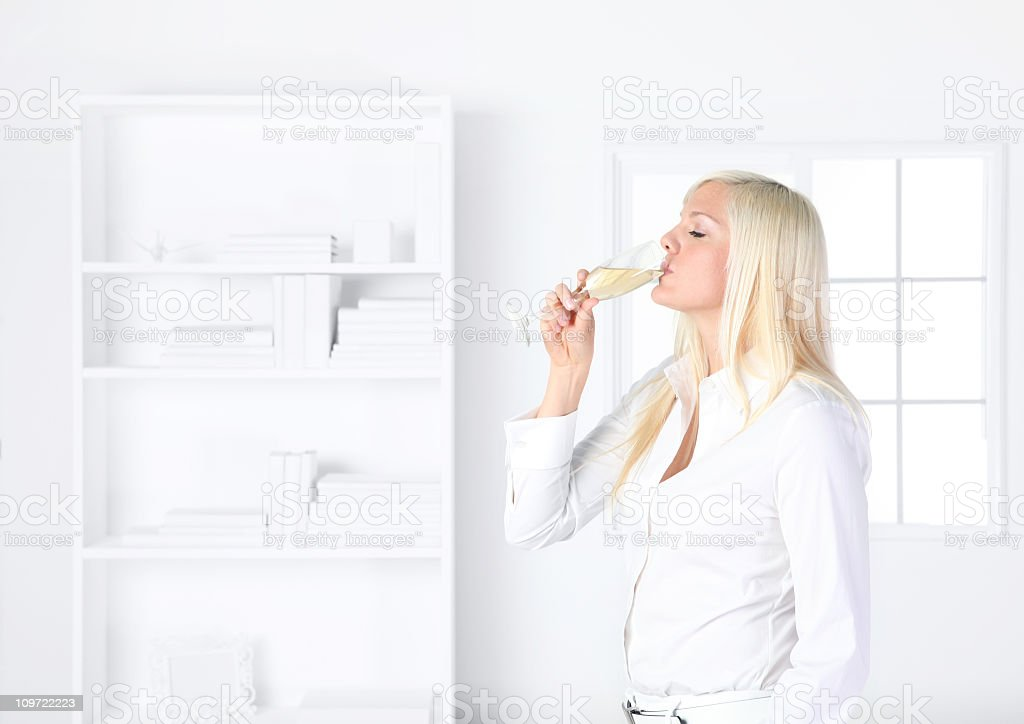 Woman drinking champagne royalty-free stock photo