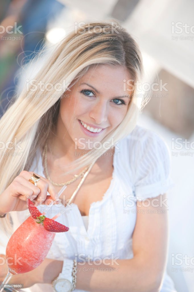 Woman drinking cocktail stock photo