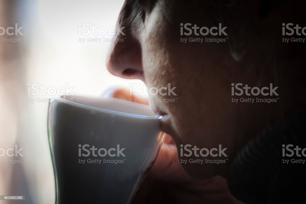 Woman drinking coffe stock photo