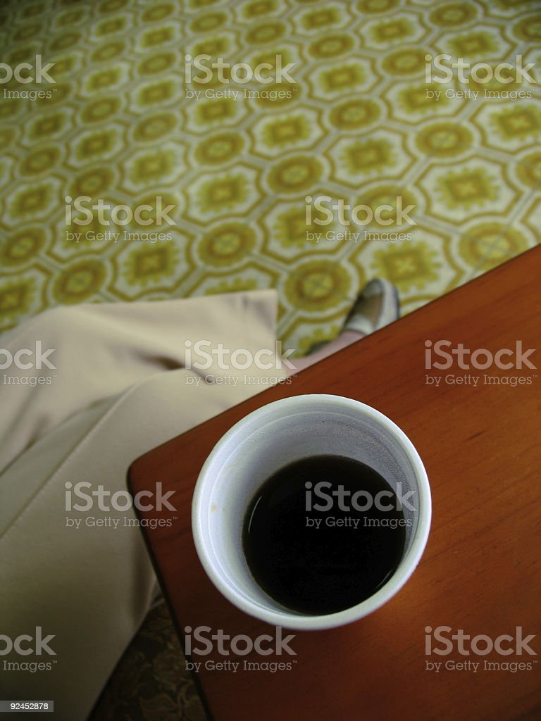 Woman Drinking Coffee at a Salon royalty-free stock photo