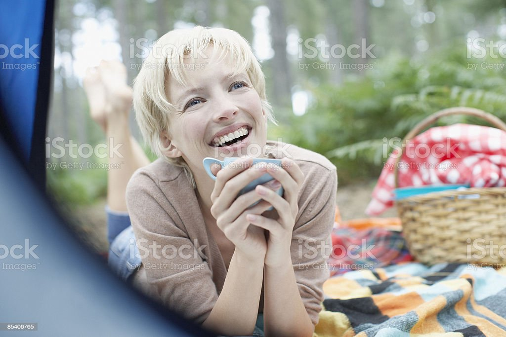 Woman drinking coffee at campsite royalty-free stock photo