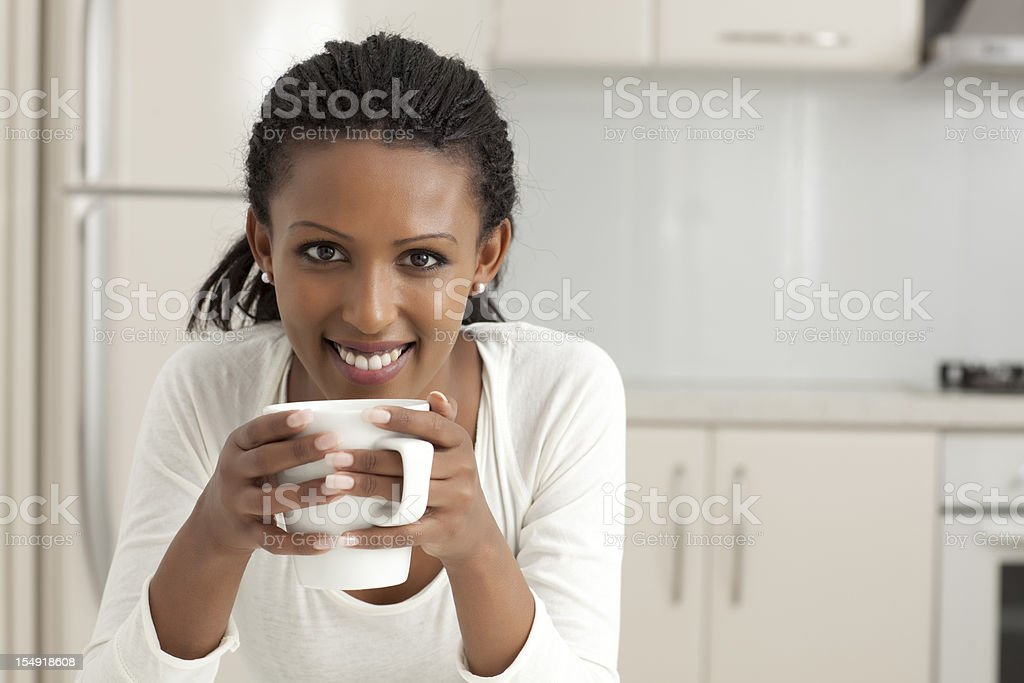 Woman drinking coffee at kitchen. royalty-free stock photo