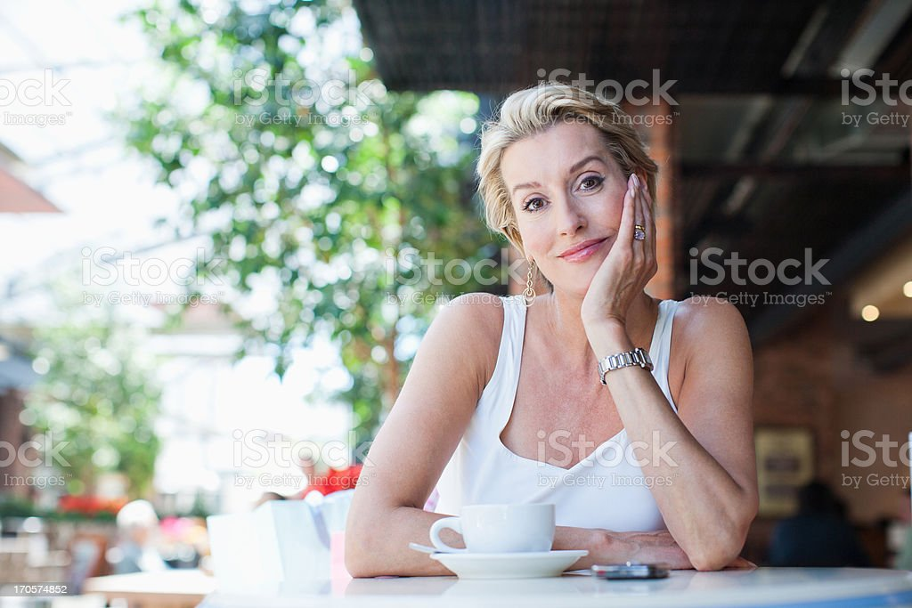 Woman drinking coffee in cafe royalty-free stock photo