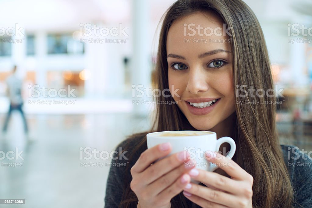 woman drinking coffee in the morning at restaurant soft focus. stock photo