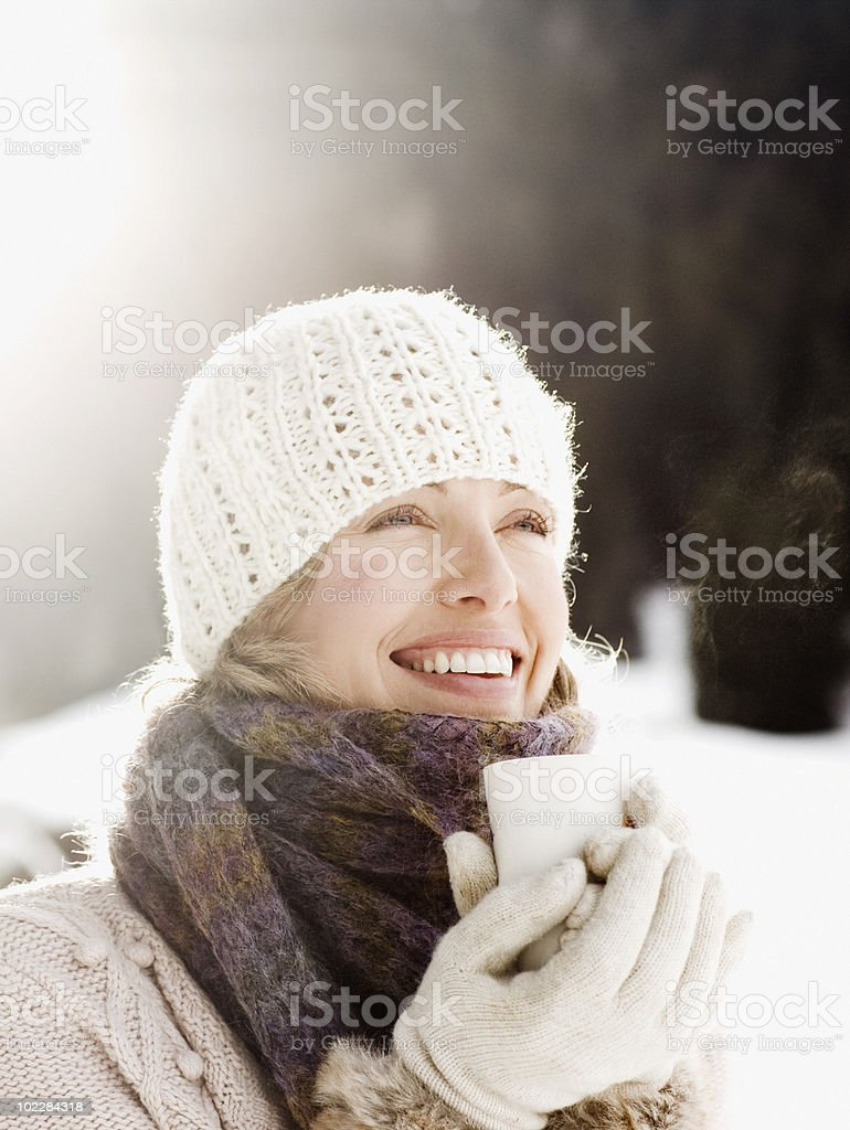 Woman drinking coffee outdoors in snow royalty-free stock photo