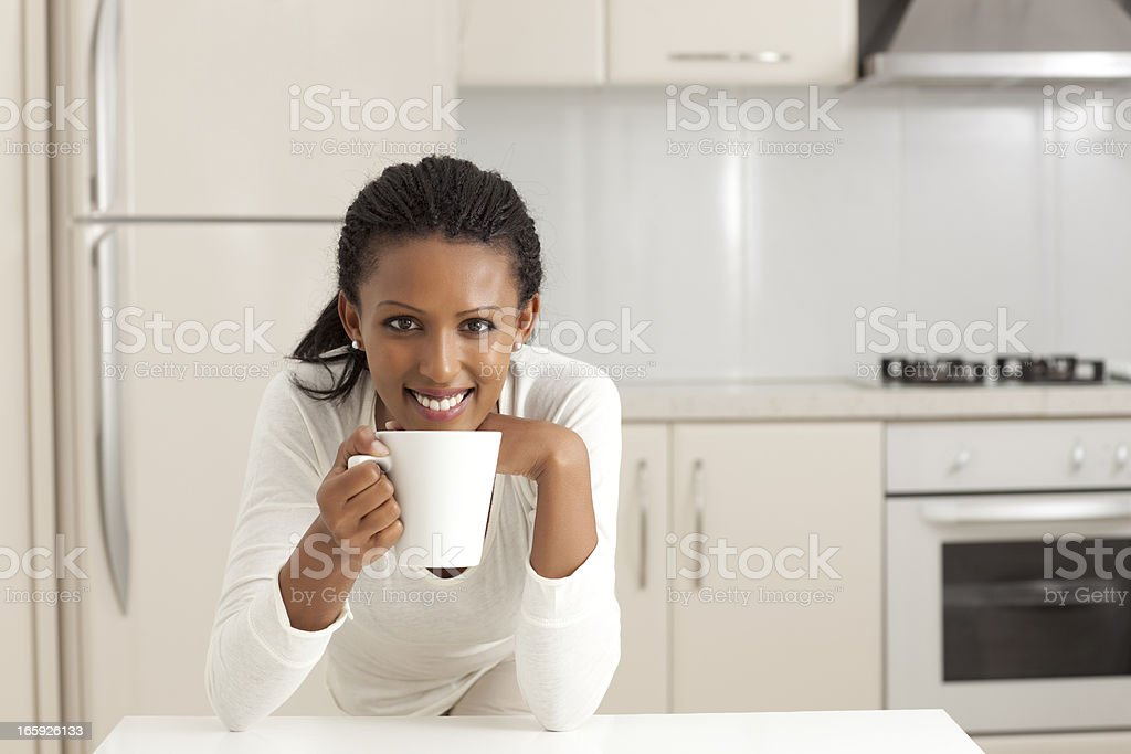 Woman drinking coffee, sitting at kitchen. royalty-free stock photo